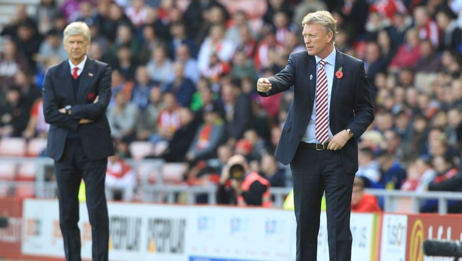 Arsene Wenger dan David Moyes saat mereka berjumpa